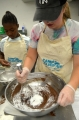 Teen Chefs mixing ingredients to make chocolate cupcakes