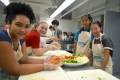 Teen Chefs chopping and cutting vegetables