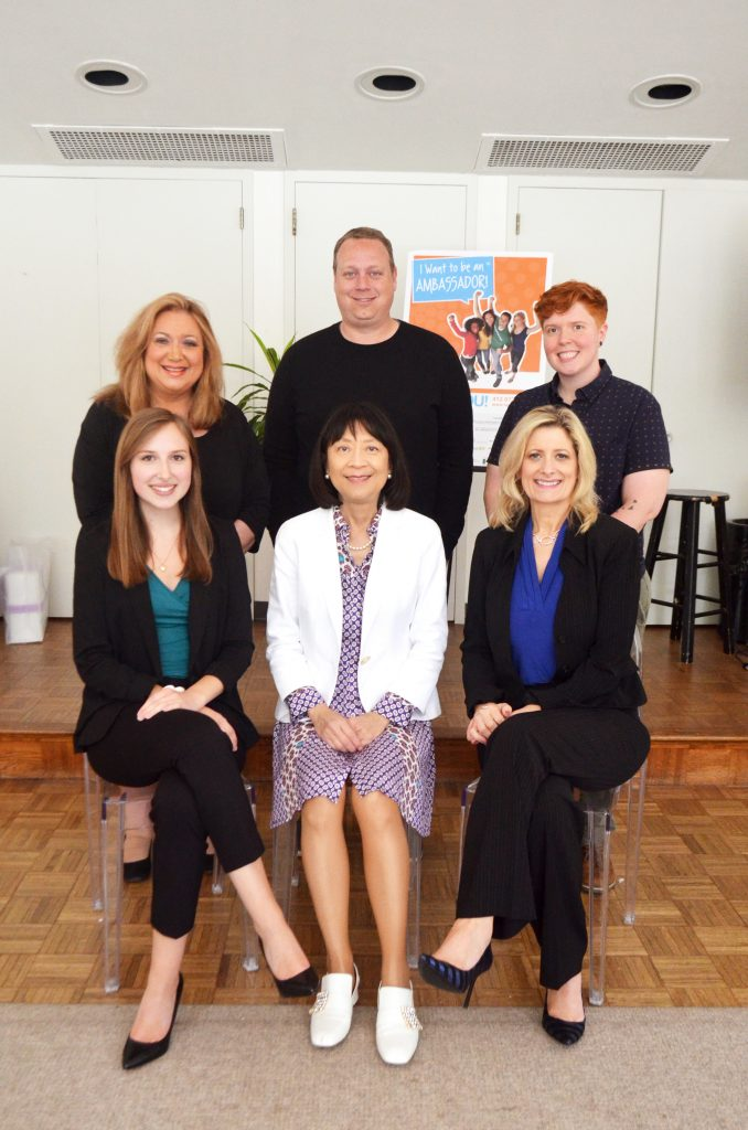 2019 Ambassador team: Back Row L-R: Susan Brozek Scott, Director; Kyle Smith, Assistant Director; Ash Warren, Videography Fellow; Front Row L-R: Camille Traczek, Operations Intern; Hilda Pang Fu, President; Sheila Hyland, Operations Manager.