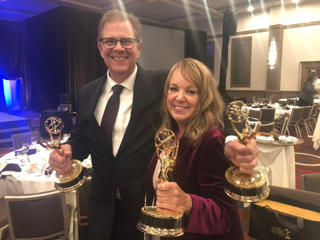 Patrick helping Beth hold all her Emmys.